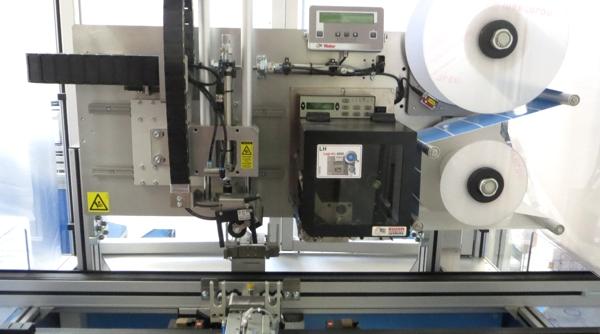 Maschine zum Banderolieren von Dialysefiltern